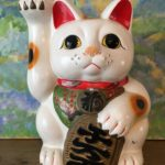 Large White Ceramic Lucky Cat with Plum Blossoms
