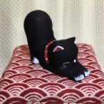 Black Stretching Ceramic Cat on Zabuton Pillow